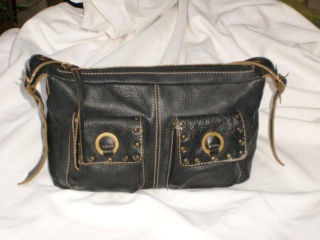 JANE SHILTON black leather shoulder bag with saddle details. The bag has  contrast stitch and metal brass details including buckles to adjust strap  length 5410c2aba3a9c