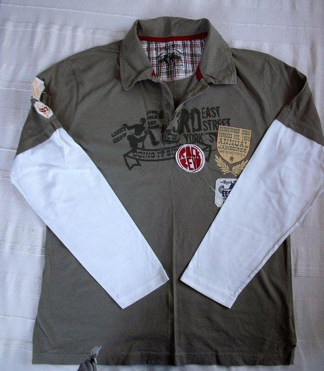 Preview of the first image of Cherokee khaki/white cotton long sleeve/collar man's top. M..