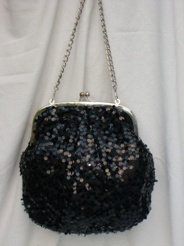 4a221283a79c2 Fabulous black sequin evening bag with silver toned metal chain shoulder  strap. The bag has black sequins on both sides