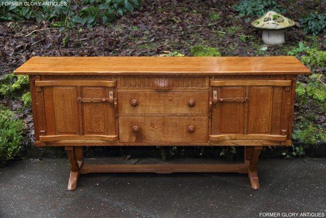 Preview of the first image of A RUPERT NIGEL GRIFFITHS SOLID OAK DRESSER BASE SIDEBOARD.