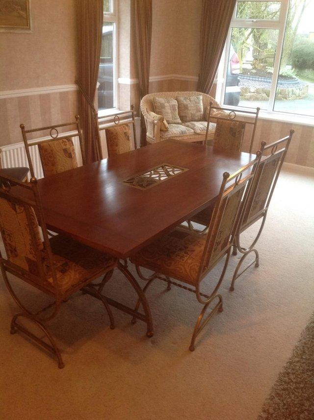 6 Seater Dinning Table Hard Wood Top With No Chips Or Scratches Ornate Solid Metal Frame Padded Chairs All In Excellent Condition
