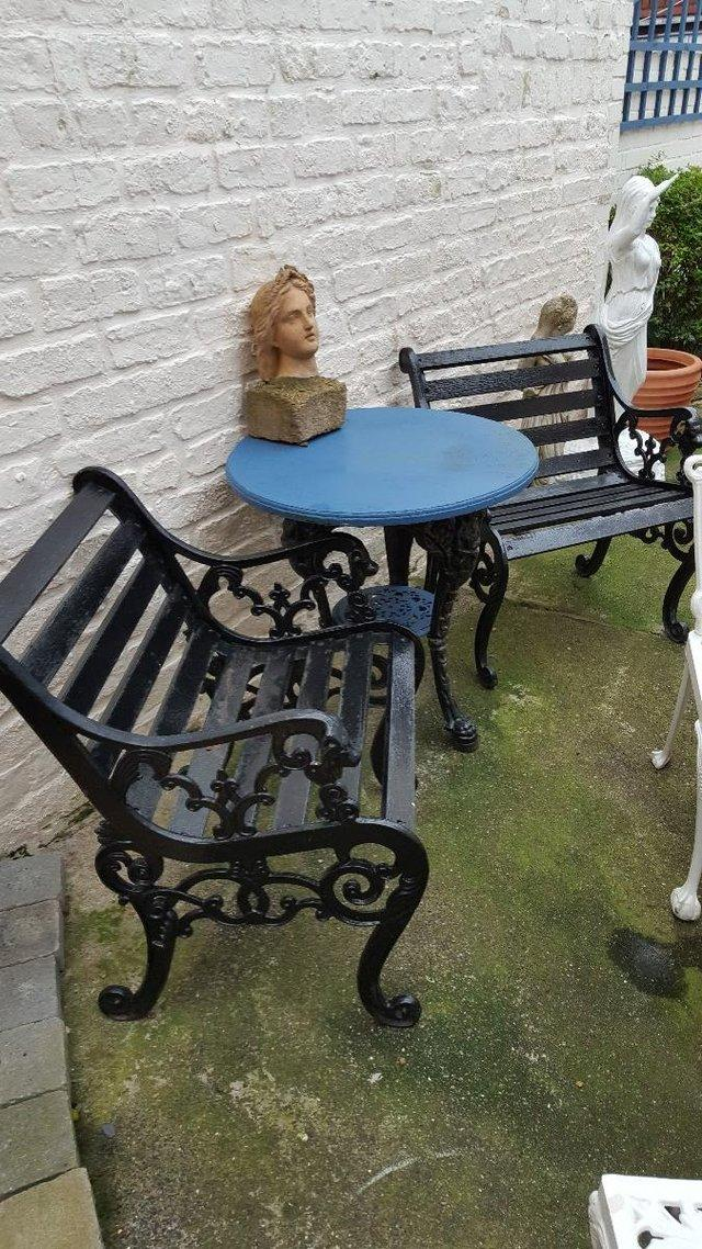 for the garden comprises of an antique cast iron britannia table and 2 lion head cast iron chairs table has had top and bottom shelf painted blue to - Garden Furniture Kings Lynn