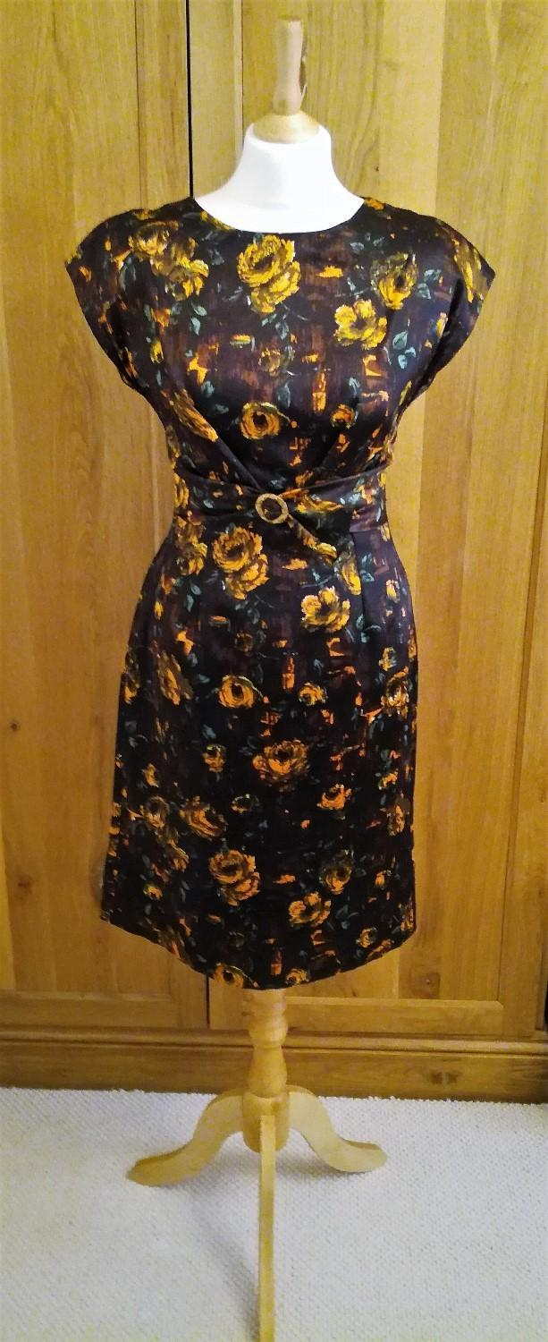 Preview of the first image of 1960 VINTAGE Wiggle Dress Silhouette Brown Gold Buckle.