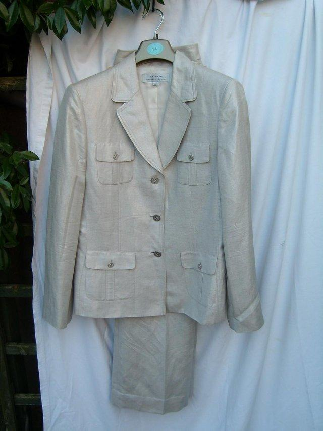 Preview of the first image of ARTHUR S LEVINE TAHARI Silver Trousers/Jacket Size 12/14.