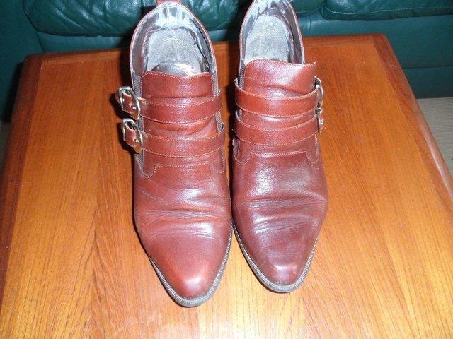 4a9bf1fed70 ... brown leather ladies ankle boots. Size 4 or 37 with a wood effect cuban  heel It has elasticed sides with 2 leather straps across the front and a  tab on ...