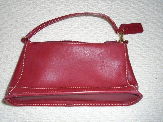 871deac714f2 1990s vintage small Coach dark red leather handbag. Cowhide. Number on  label inside bag  B1P - 9311. Good condition. No receipt available as  handbag ...