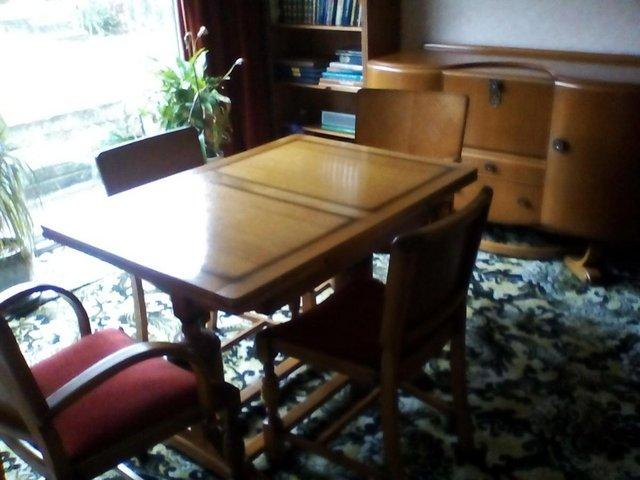1950s Style Dining Room Set All In Honey Coloured Solid Wood With Ornate Handles On The Sideboard Table Extends At Both Ends If Required
