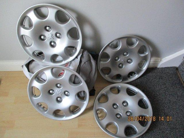 """Preview of the first image of PEUGEOT 15"""" WHEEL TRIMS."""