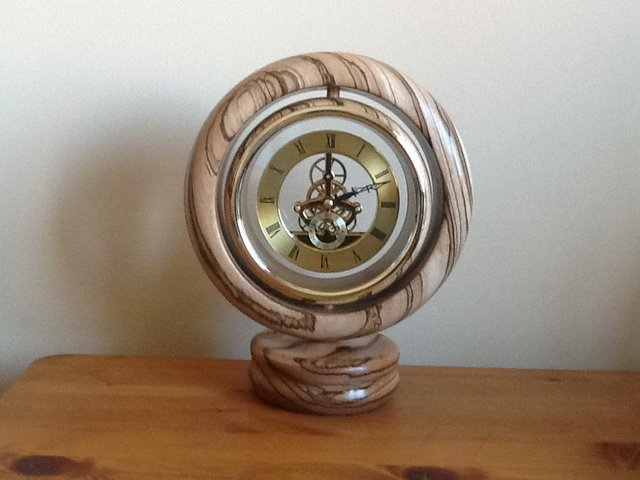 Preview of the first image of Zebra wood clock.