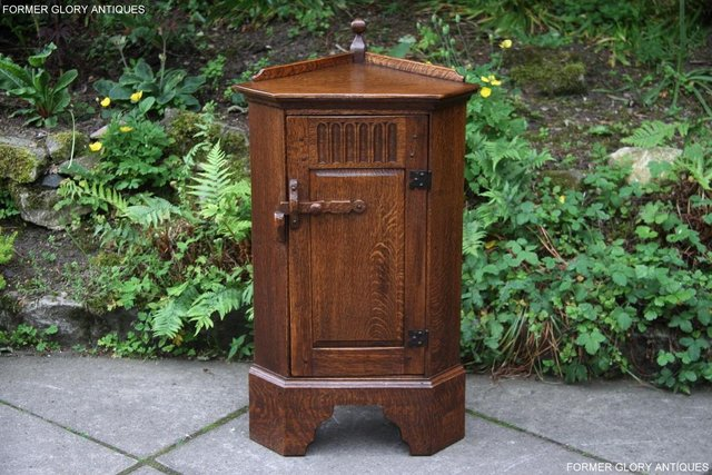 Preview of the first image of A NIGEL RUPERT GRIFFITHS CARVED OAK CORNER CABINET CUPBOARD.