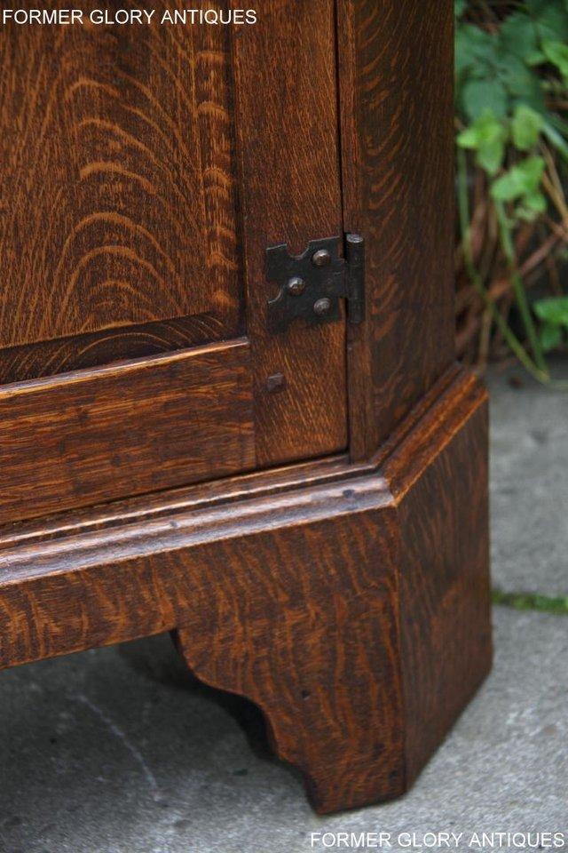 Image 9 of A NIGEL RUPERT GRIFFITHS CARVED OAK CORNER CABINET CUPBOARD