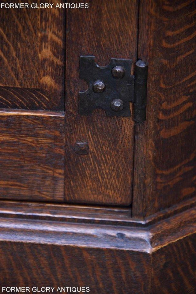 Image 12 of A NIGEL RUPERT GRIFFITHS CARVED OAK CORNER CABINET CUPBOARD