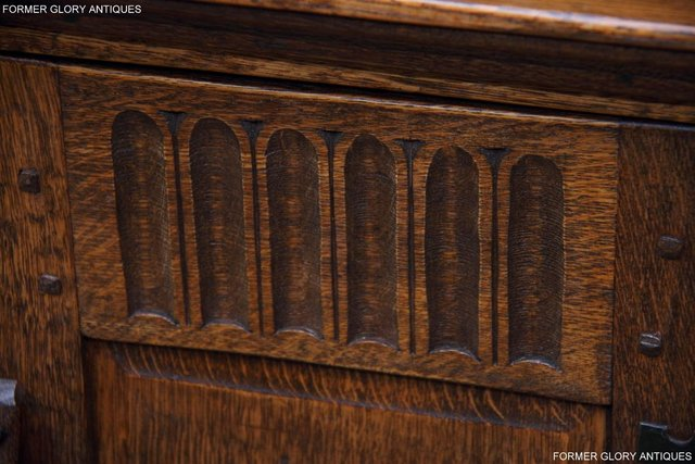 Image 15 of A NIGEL RUPERT GRIFFITHS CARVED OAK CORNER CABINET CUPBOARD