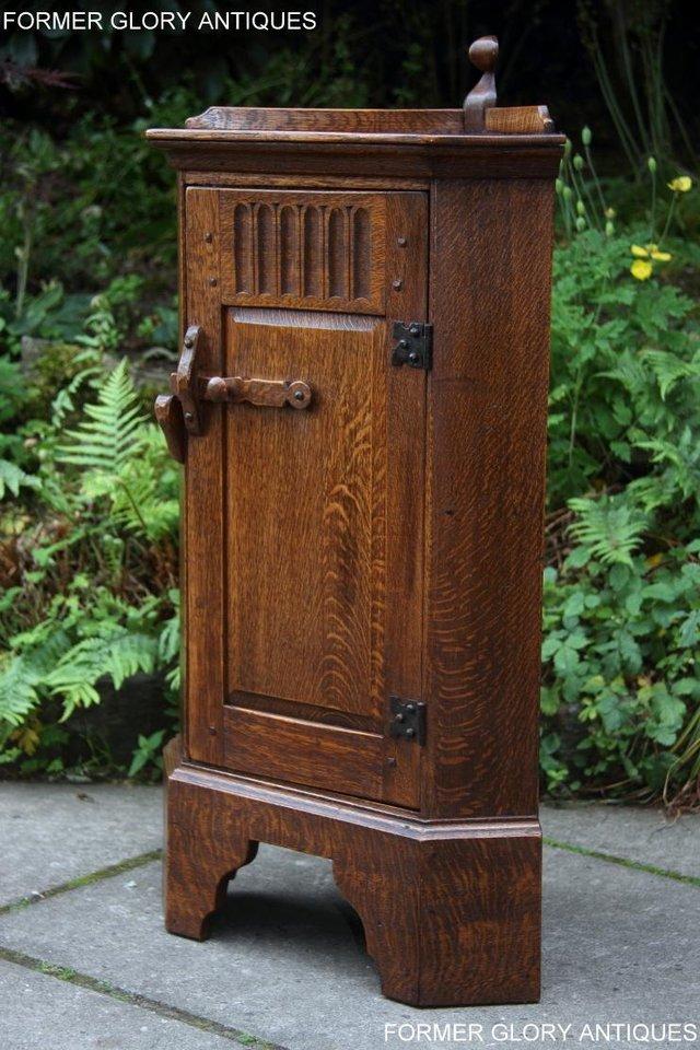 Image 36 of A NIGEL RUPERT GRIFFITHS CARVED OAK CORNER CABINET CUPBOARD