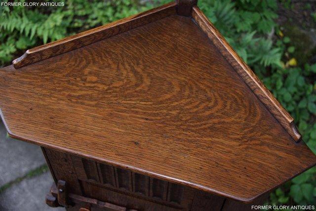 Image 37 of A NIGEL RUPERT GRIFFITHS CARVED OAK CORNER CABINET CUPBOARD