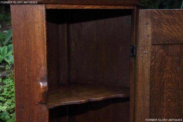 Image 40 of A NIGEL RUPERT GRIFFITHS CARVED OAK CORNER CABINET CUPBOARD