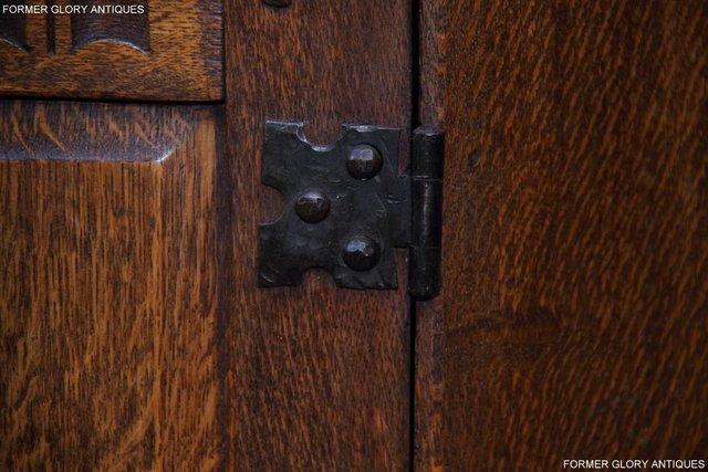 Image 41 of A NIGEL RUPERT GRIFFITHS CARVED OAK CORNER CABINET CUPBOARD