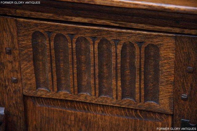 Image 42 of A NIGEL RUPERT GRIFFITHS CARVED OAK CORNER CABINET CUPBOARD