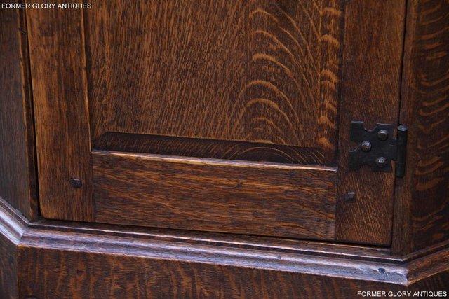 Image 54 of A NIGEL RUPERT GRIFFITHS CARVED OAK CORNER CABINET CUPBOARD