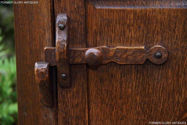 Image 72 of A NIGEL RUPERT GRIFFITHS CARVED OAK CORNER CABINET CUPBOARD