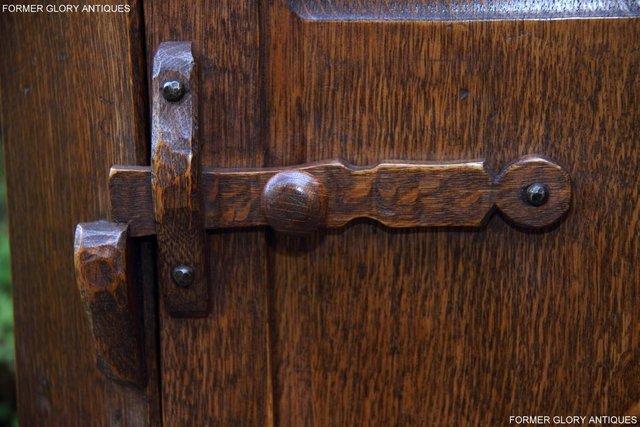 Image 78 of A NIGEL RUPERT GRIFFITHS CARVED OAK CORNER CABINET CUPBOARD