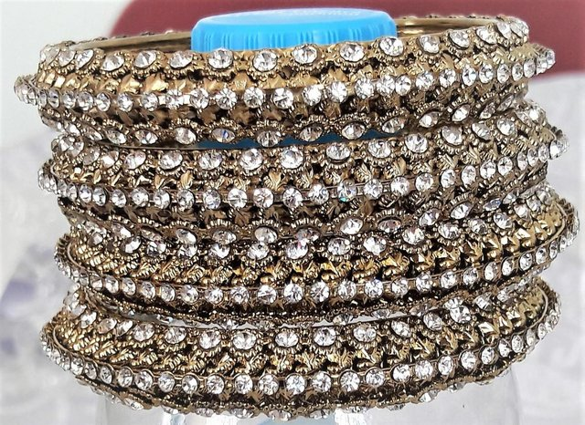 Preview of the first image of 4 Indian gold and diamante wedding bangles.