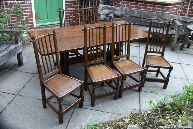 Preview of the first image of A NIGEL RUPERT GRIFFITHS OAK DINING SET TABLE & SIX CHAIRS.