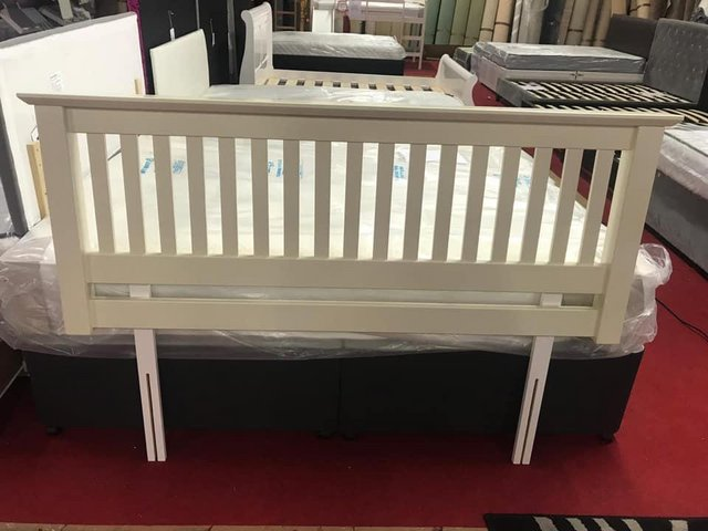 Preview of the first image of cream kingsize wooden headboard ex display.