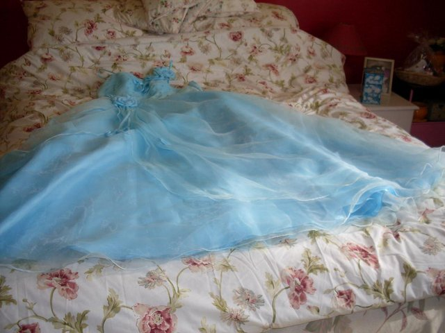 Preview of the first image of AQUA BLUE EVENING/BALL GOWN SIZE 14-16 ( NEW AND UNWORN ).
