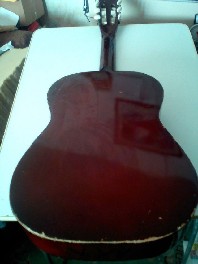 Preview of the first image of Prince quality Acustic Guitar ,only got 5 strings.