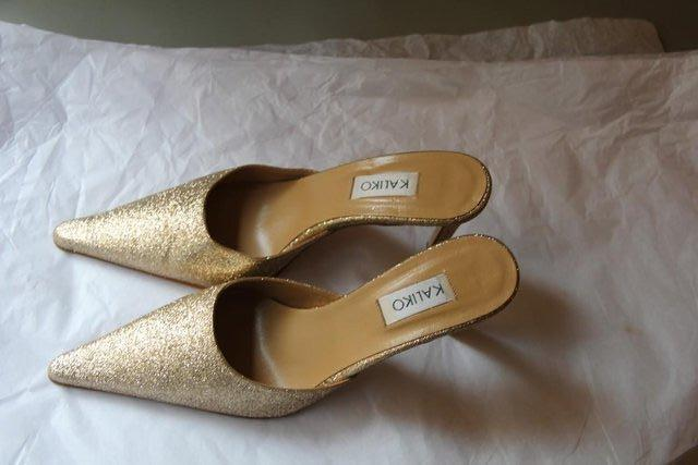 Preview of the first image of Kaliko Brand - Gold Sparkle Shoes – Size 5 / 38.