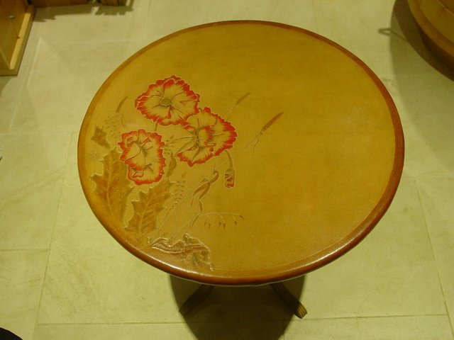 Preview of the first image of tooled leather occasional table with tilting top.