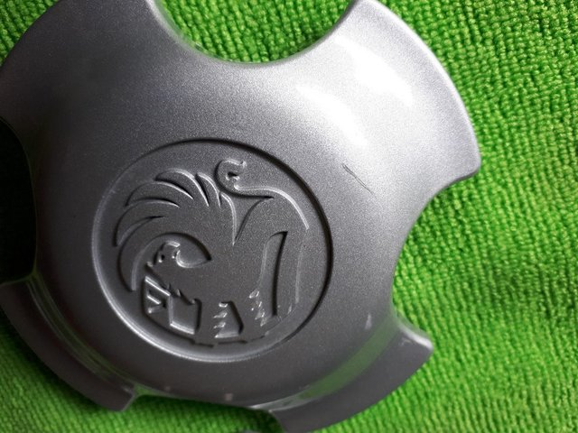 Preview of the first image of Vauxhall Astra Tigra Corsa Alloy Wheel CenterCovers x3.
