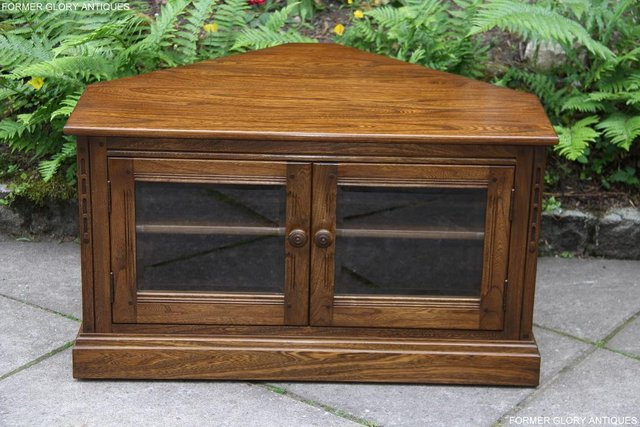 Preview of the first image of ERCOL GOLDEN DAWN ELM CORNER TV CABINET STAND TABLE UNIT.