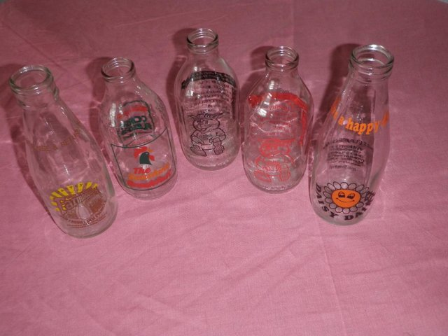 Preview of the first image of Five Decorative Pint Glass Milk Bottles.