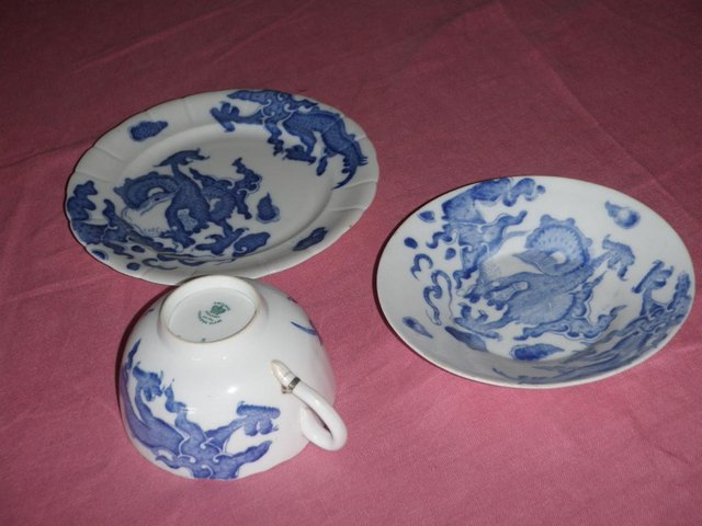 Preview of the first image of Blue and white cup saucer and plate with dragon design.