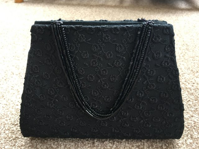 Preview of the first image of Handbag evening bag by Dents.