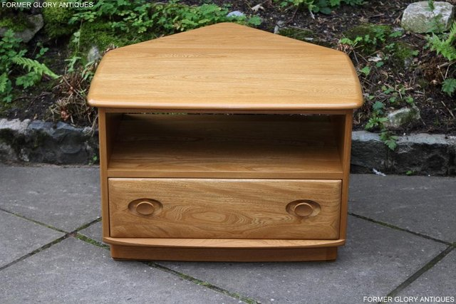Preview of the first image of AN ERCOL WINDSOR LIGHT ELM CORNER TV CABINET DVD TABLE STAND.