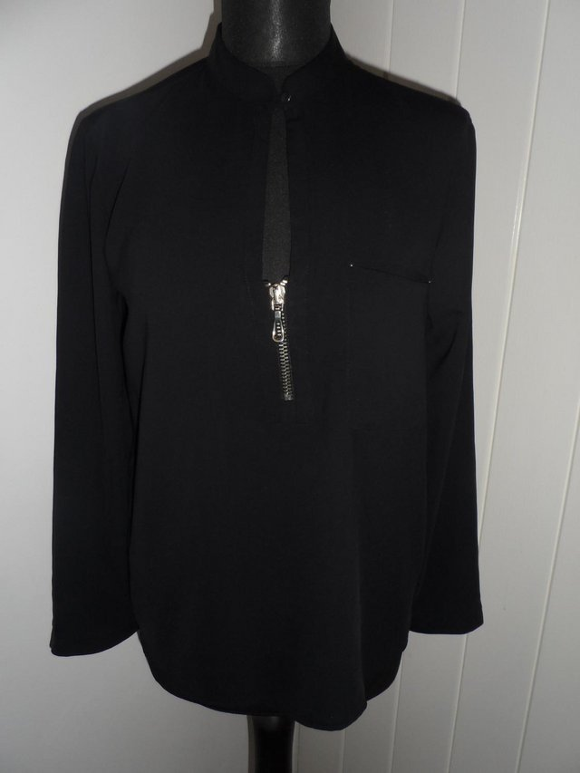 Preview of the first image of BLANCO (ZARA GROUP) Black Loose Shirt with Gold Zip Detail.