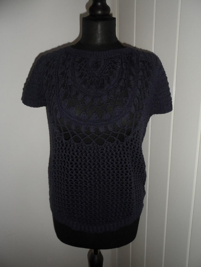 Preview of the first image of F&F Navy Blue Open Knit Short Sleeve Jumper in Size 6-8.