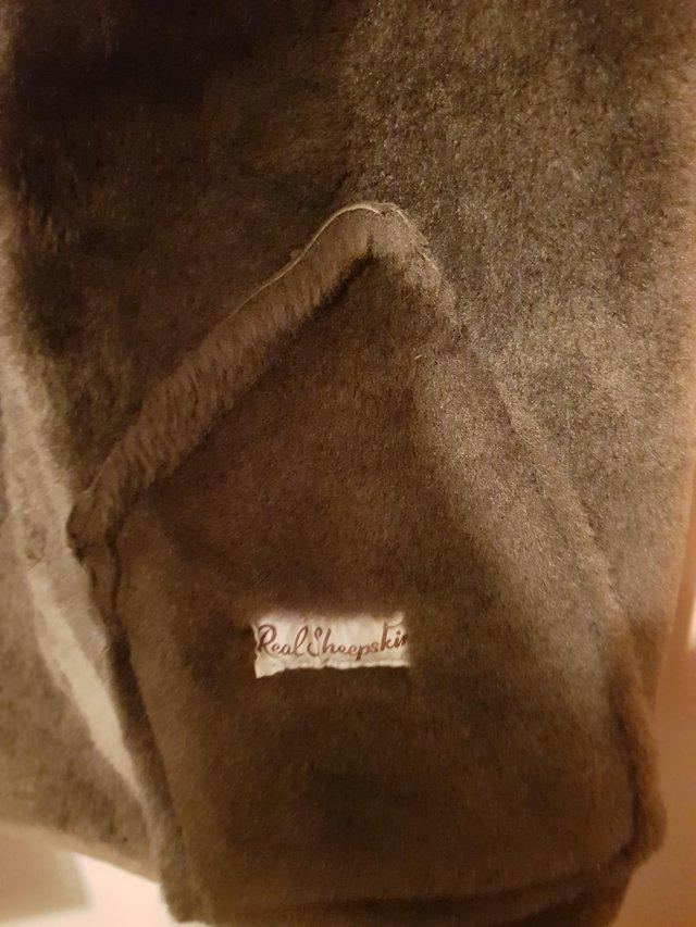Preview of the first image of Women's Brown Sheepskin Coat.