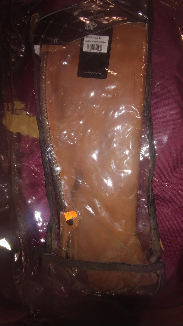 Preview of the first image of New Horze brown leather half chaps large.