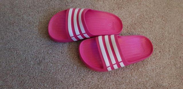 Preview of the first image of Adidas flip flops childrens size 11.
