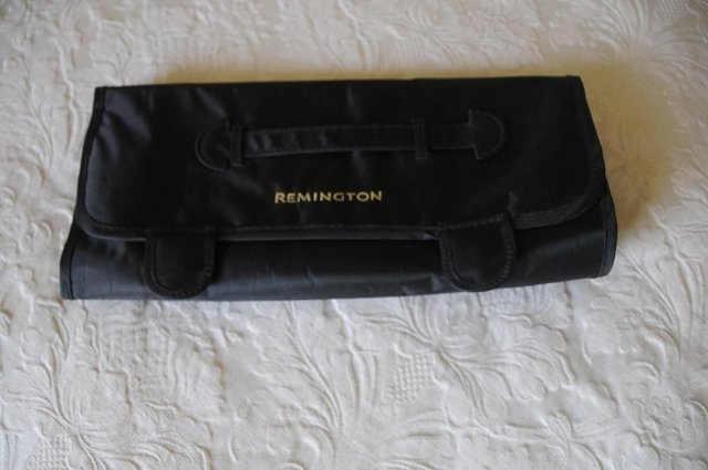 Preview of the first image of Remington Heat Resistant Safety Mat And Storage Pouches.