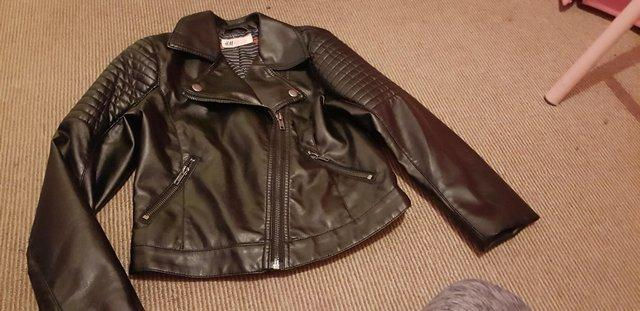 Preview of the first image of Girl leather look jacket age 7/8.