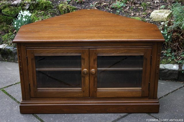 Preview of the first image of AN ERCOL GOLDEN DAWN CORNER TV CABINET DVD STAND TABLE UNIT.