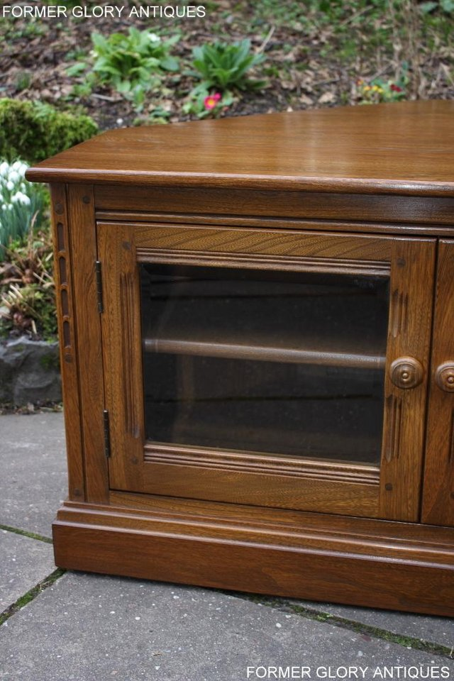 Image 67 of AN ERCOL GOLDEN DAWN CORNER TV CABINET DVD STAND TABLE UNIT