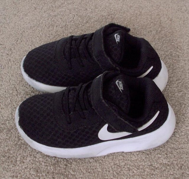 black trainers size 8.5
