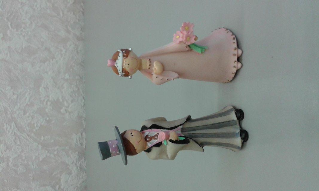Preview of the first image of Man and woman figurines.