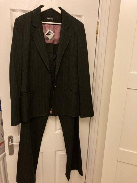 Preview of the first image of Black pinstripe size 14/16 ladies suit with trousers.